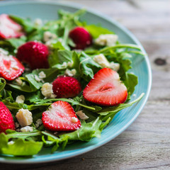 Salad with arugula,strawberries and cheese