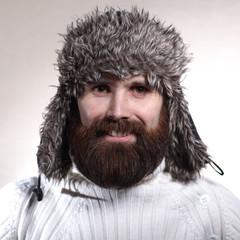 portrait of a bearded wearing hat lumberjack, brutal