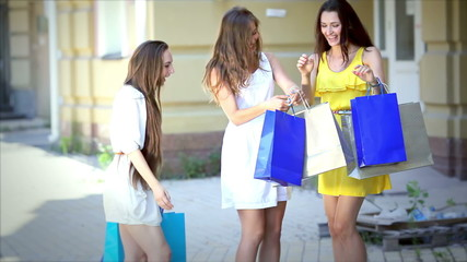 Three pretty girls-shopaholic jumping for joy after shopping