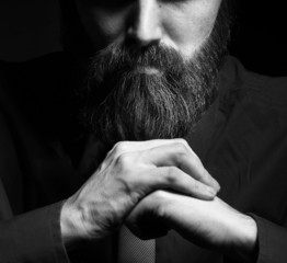 Portrait of brutal man with a beard