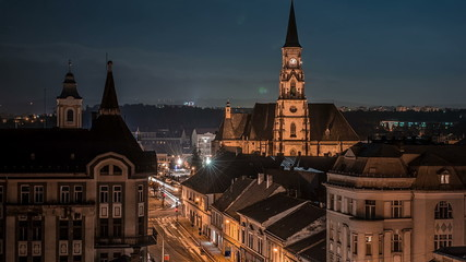 Old European  town cathedral intersection night lifestyle