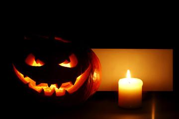 Halloween pumpkin, candle and card