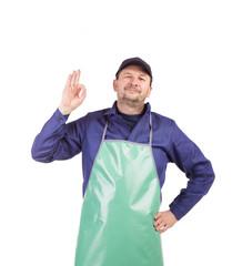 Worker wearing blue apron.