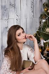 woman near Christmas tree