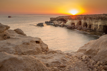 Sea caves at sunset. Mediterranean Sea. Nature composition