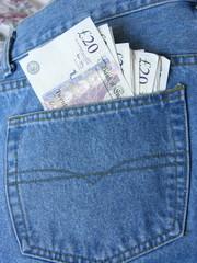 Twenty pound notes in jeans pocket