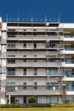 Modern residential building under refurbishment poster
