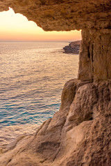 Inside view of sea cave at sunset. Nature composition