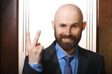 businessman victory gesture portrait