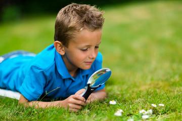 Boy with microscope