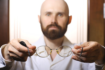 doctor checking vision goggles