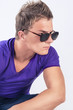 Young Caucasian Man in Eyeglasses Staring Away
