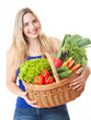 Young healthy beautiful woman with a basket full of fresh vegeta