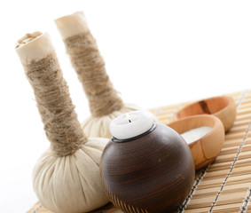spa still life with spa herbal balls, candlestick and salt in wo