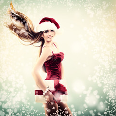 Beautiful cheerful fashion christmas girl in Santa's hat with gi