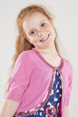 Portrait of Happy Redhaired Caucasian Girl wearing Polka dotted