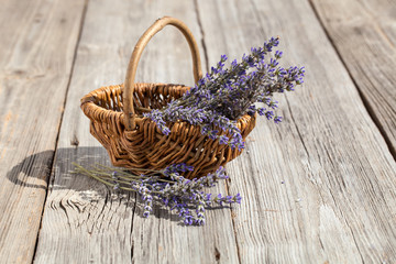 Basket with a lavender, on wooden background
