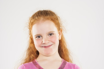 Portrait of Smiling Caucasian Redhaired Little Girl