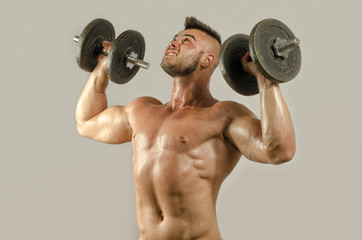 Strong bodybuilder with perfect abs, shoulders,biceps, triceps