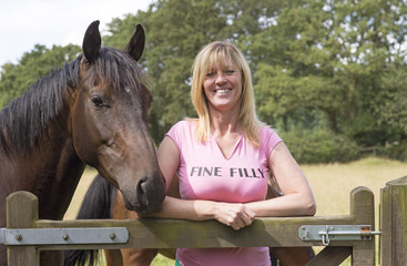 Woman in T shirt Fine Filly and horse