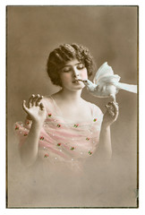 vintage portrait of young woman with a dove