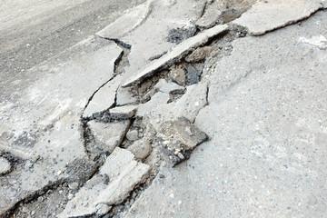 Broken cracked asphalt pavement in Russia