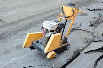 Circular small drill breaking street asphalt
