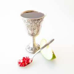 Kiddush cup Pomegranate seeds and sliced apple