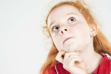 Thinking Red-haired Girl Looking Up and Touching Chin