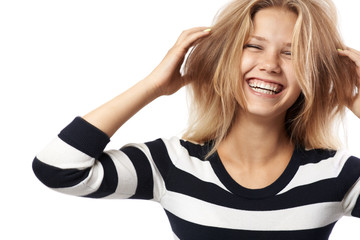beautiful girl in a striped sweater laughing