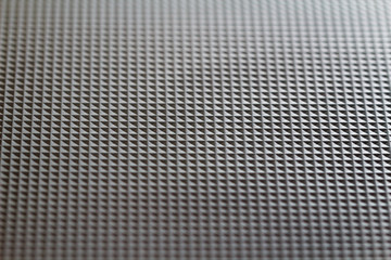 Structure from identical squares on black plastic