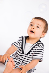isolated studio portrait lovely toddler baby boy playing
