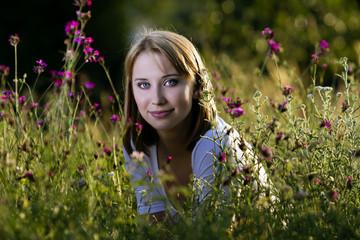 Woman in blooming meadow