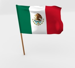 waving mexico flag on the flag pole