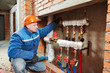 heating engineer repairman in boiler room - 69216843