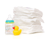 child stack of diapers baby feeding milk bottle with water