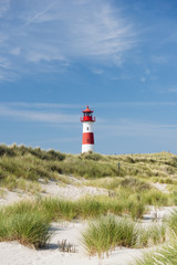 Lighthouse on dune. Focus on background with lighthouse.