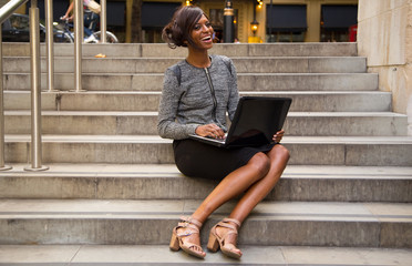 happy young woman with laptop.