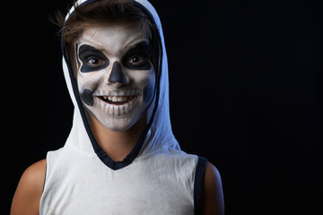 teenager with a skull makeup