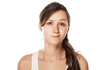 dissatisfied young woman posing on a white background