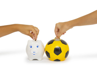 Hands Putting Coin In Piggy Bank