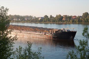 A big ship carrying wood