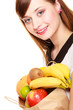 Grocery. Girl holding paper shopping bag with fruits