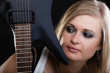 Rock music. Girl musician guitarist with electric guitar