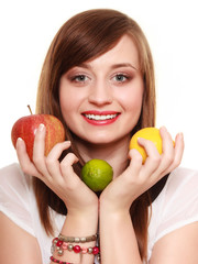 Healthy diet and nutrition. Girl holding fruits.