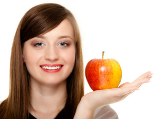Diet. Girl offering apple seasonal fruit.