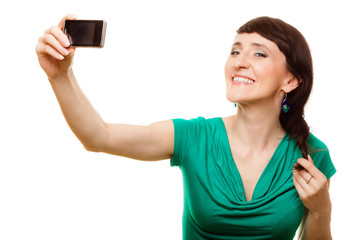 Happy woman taking self picture with smartphone