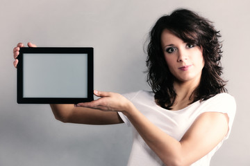 Student girl showing copy space on tablet touchpad
