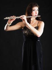 Art. Woman flutist flaustist musician playing flute