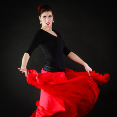 Dance. Spanish girl in red skirt dancing flamenco